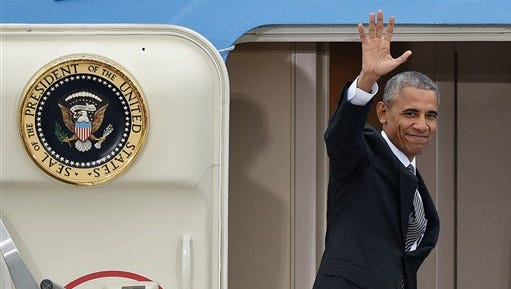 US president Barack Obama  waves as he departs from  Tegel airport in Berlin  Friday Nov. 18, 2016. Obama  met the leaders of key European countries to discuss an array of security and economic challenges facing the trans-Atlantic partners as the U.S. prepares for President-elect Donald Trump to take office in January.
