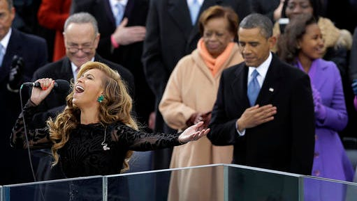 """FILE - This Jan. 21, 2013 file photo shows President Barack Obama, right, as Beyonce sings the National Anthem at the ceremonial swearing-in at the U.S. Capitol during the 57th Presidential Inauguration in Washington. On Wednesday, President-elect Donald Trump picked """"America's Got Talent"""" star Jackie Evancho to sing the national anthem at his inauguration."""