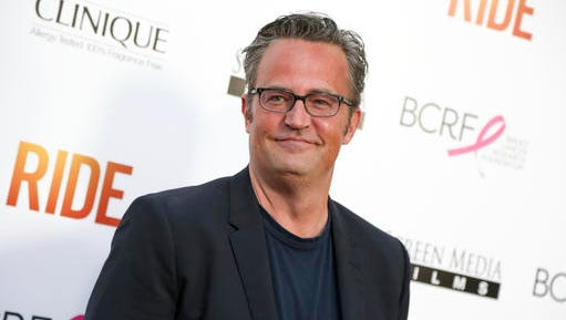 "FILE - In this April 28, 2015, file photo, Matthew Perry arrives at the LA Premiere of ""Ride"" in Los Angeles. The former ""Friends"" star appears with Katie Holmes, who reprises her role as Jackie Kennedy in ""The Kennedys After Camelot,"" which premieres on the Reelz channel on April 2."