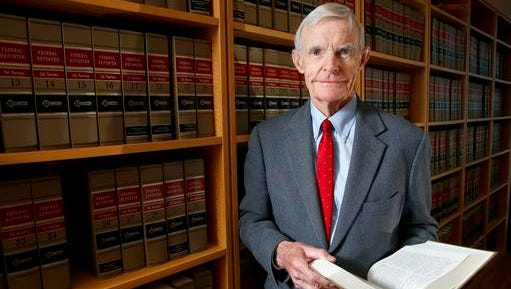 FILE - In this Nov. 4, 2015, file photo, Judge William Canby is photographed in his office in Phoenix, Ariz. Canby is one of three judges on the San Francisco-based 9th Circuit Court of Appeals deciding whether to reinstate President Donald Trump's travel ban.