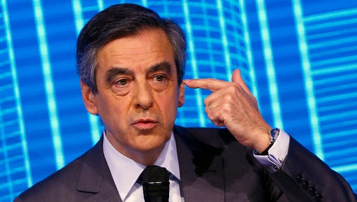"""Francois Fillon, candidate for the 2017 French presidential elections of the right-wing Les Republicains (LR) party participates to the Construction Forum debate """"reinvest France"""" (""""Reinvestissons la France"""") at Carrousel du Louvre in Paris, Thursday, Feb. 23, 2017."""