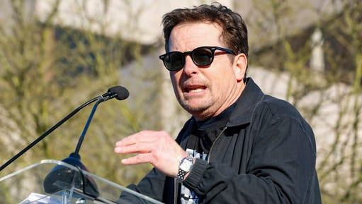 """Michael J. Fox speaks at the UTA """"United Voices"""" Rally at United Talent Agency headquarters on Friday, Feb. 24, 2017, in Beverly Hills, Calif. As most of Hollywood gears up for the Oscars on Sunday and the whirlwind of events and parties this weekend, celebrities and top talent agents gathered in Beverly Hills Friday to do something to do something a little different: rally for immigration rights."""