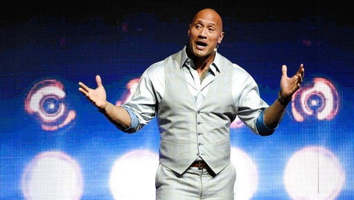 "Dwayne Johnson, a cast member in the upcoming film ""Baywatch,"" addresses the audience during the Paramount Pictures presentation at CinemaCon 2017 at Caesars Palace on Tuesday, March 28, 2017, in Las Vegas."