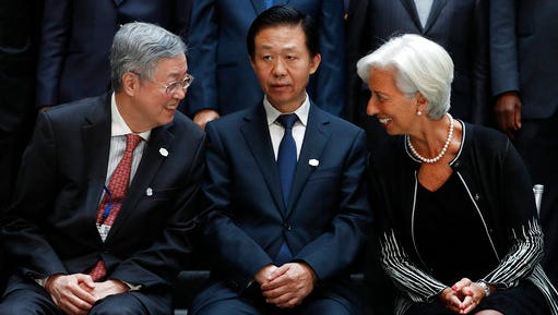 From left, German Federal Minister of Finance Wolfgang Schäuble, Zhou Xiaochuan, Governor of the People's Bank of China, Chinese Finance Minister Xiao Jie and International Monetary Fund Managing Director Christine Lagarde gather for the Family Photo during the G20 at the 2017 World Bank Group Spring Meetings in Washington, Friday, April 21, 2017.