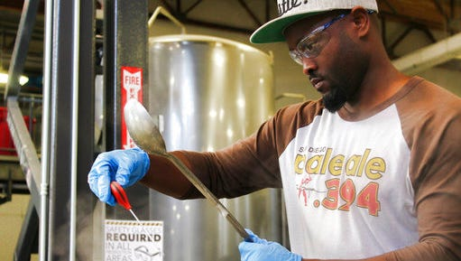 In this Feb. 16, 2017, photo provided by AleSmith, Tony Gwynn Jr. wears safety goggles as he waits for the right moment to add hops to a boil kettle as he tweaks his craft beer recipe on a two-keg system dwarfed by giant tanks at AleSmith Brewing Co. in San Diego, Calif. Gwynn followed in the footsteps of his famous father in playing at San Diego State and even with the Padres, and now he hopes to hit on something similar to San Diego Pale Ale .394, AleSmith's tribute to the late Hall of Famer.