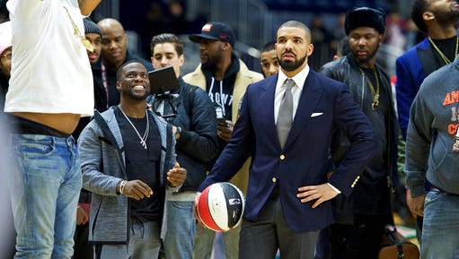 FILE - In this  Feb. 12, 2016, file photo, Kevin Hart, left, and Drake coach at the NBA All-Star Celebrity Game at Ricoh Coliseum in Toronto. The league announced on April 25, 2017, that Drake will host its first NBA Awards on June 26.