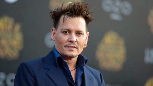 """FILE - In this May 23, 2016, file photo, Johnny Depp arrives at the premiere of """"Alice Through the Looking Glass"""" at the El Capitan Theatre, in Los Angeles. Depp's former business managers called him a """"habitual liar"""" in a statement on April 26, 2017. The managers were responding to Depp's criticism of them in The Wall Street Journal."""