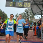 Tim and Charlotte Walters finish the 2013 Space Coast Half Marathon hand-in-hand. It was Tim's first half marathon. The couple's official time was 2:14:09.