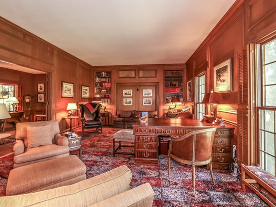 The library/study opens off the foyer of the 15-acre Flanigan estate at 2750 Holcomb Ranch Lane south of Windy Hill. The walls are covered in suede.