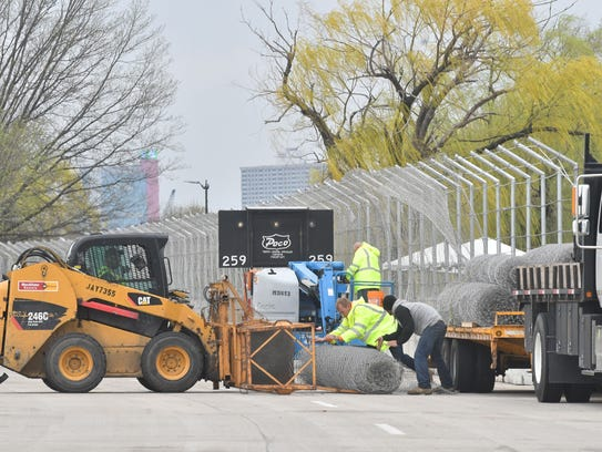 Workers build fencing along the south side of Belle