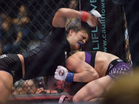 Guam's Brogan Walker defeats Kate Da Silva of New Zealand by unanimous decision at PXC 54 at the University of Guam Calvo Field House on Friday, July 8, 2016.