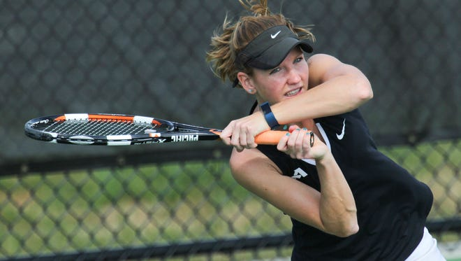 Anderson University's Rebecca Bruning, playing No. 1 doubles with Laura Dean, returns a ball Tuesday to Claudia De Andreis and Oroma Womeodu at the Anderson University Sports Complex.