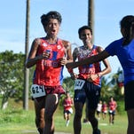 An Okkodo High Bulldog stays ahead of the pack during the Independent Interscholastic Athletic Association of Guam Cross-Country League meet at George Washington High School in Mangilao on Aug. 31.