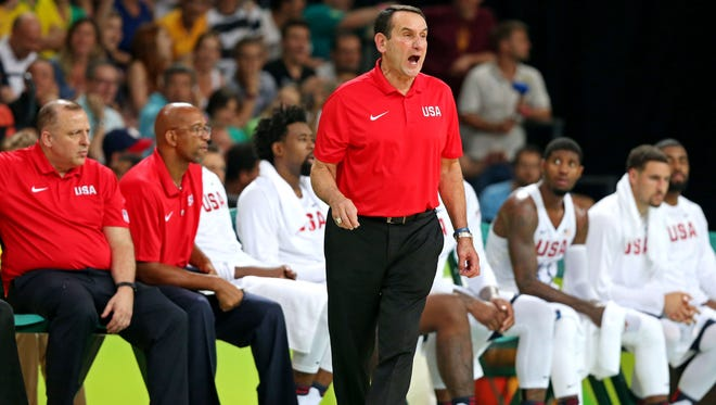 USA coach Mike Krzyzewski calls to his player against Argentina during the men's basketball quarterfinals in the Rio 2016 Summer Olympic Games at Carioca Arena 1.