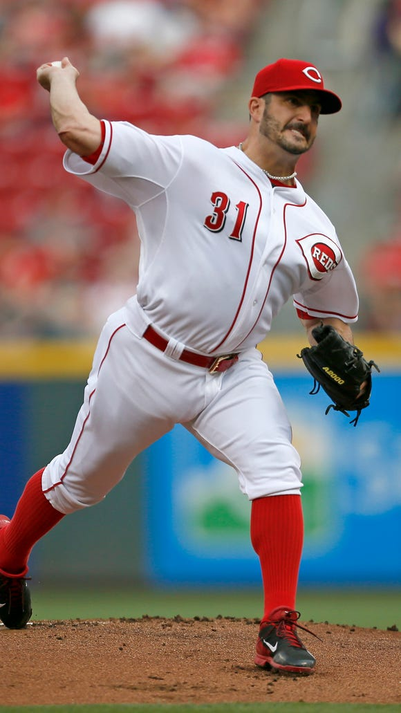 Reds starting pitcher Jason Marquis (31) delivers a pitch against the Giants at Great American Ballpark last Friday.