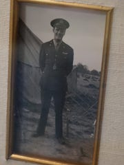 A photo of 1st Lt. Howard Games is surrounded by medals