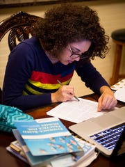 Zacnite Vargas works on her homework at the family home, Thursday, Nov. 17, 2016, in Nashville, Tenn. Vargas is a Deferred Action for Childhood Arrivals (DACA) nursing student at Belmont University and is taking general education classes at Trevecca.