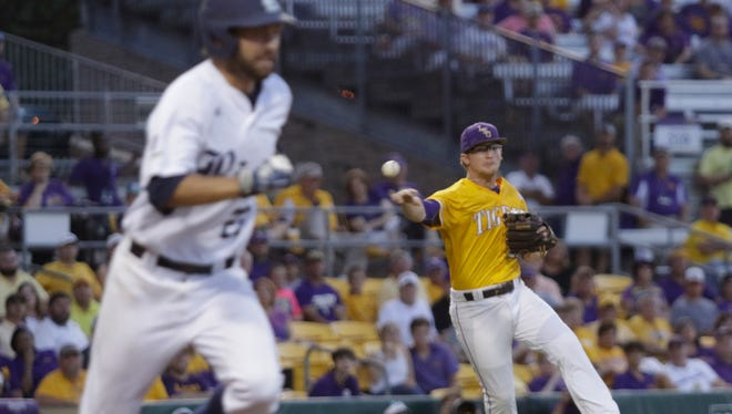 LSU third baseman Chris Reid throws out Grayson Lewis  on Monday 6/6/16 at Alex Box Stadium in the Baton Rouge Regional of the NCAA Division 1 Baseball Championship.John Rowland/Special to the Advertiser