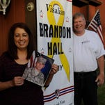 Jana and Gary Cole stand next to a banner in 2012 honoring her son, Brandon Hall, who is serving in the Army. This was the beginning of the BRAVE Project Visalia which currently has 40 banners hanging from light poles on Caldwell Avenue honoring men and women who are serving in the military. Now that Caldwell Avenue is full, 10 banners will be hung on South Akers Street Jan. 27.