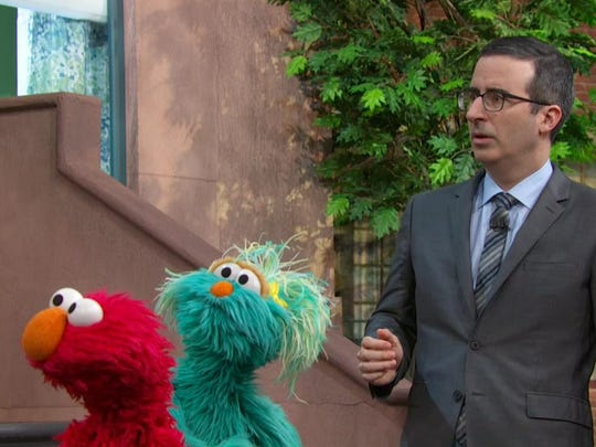 "John Oliver, the host of the HBO weekly TV show, ""Last Week Tonight with John Oliver,"" got some help from Elmo and the other puppets who live on Sesame Street in weighing in on the Flint water crisis."