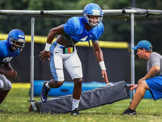 University of Memphis defensive back Josh Perry (middle)