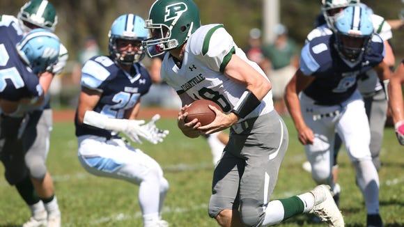 Pleasantville quarterback Jack Howe (18) finds some