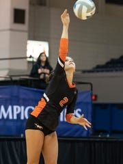 Northville's Gabi Fisette serves during the Division 1 volleyball semifinal Friday against Rockford at Kellogg Arena.
