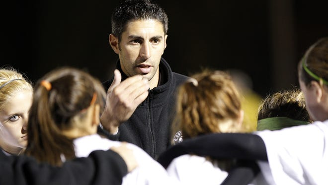 Nino Pilato, center, the new soccer coach at McQuaid, guided the Greece Odyssey girls to eight Section V titles in his 17 seasons there.