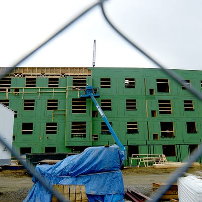 Work continues at 1855 Place, a mixed-use development,