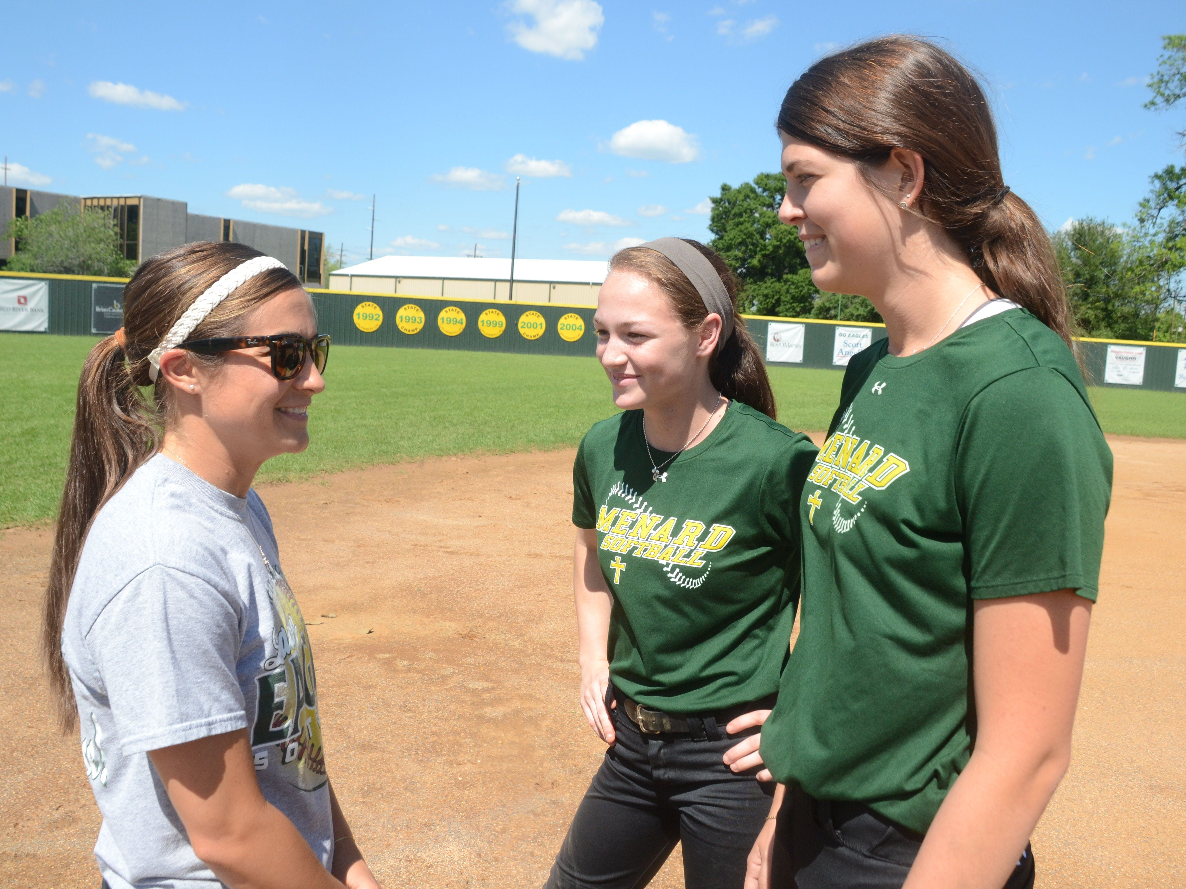 Menard softball coach Allison Frye (left) and Lady Eagles Maddie Smith and Kayla Busby are headed back to Sulphur for the Class 2A state softball tournament Friday.