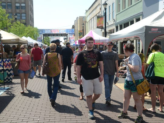Crowds walk past vendors at Alex RiverFete held Saturday in downtown Alexandria.