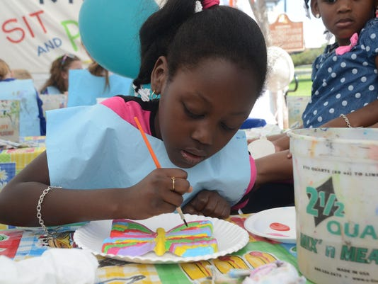 "ANI Alex RiverFete Haylee Hinkston paints a butterfly at the ""Sit and Paint"" vendor's booth at Alex RiverFete held Saturday, May 2, 2015 in downtown Alexandria.-Melinda Martinez/The Town Talk"