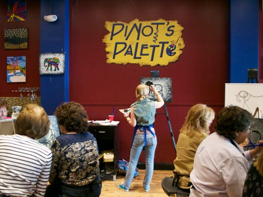 Instructor Megan Donnelly of Middletown teaches the class how to paint an elephant step-by-step during a private party at Pinot's Palette, 12 Broad St. in Red Bank.
