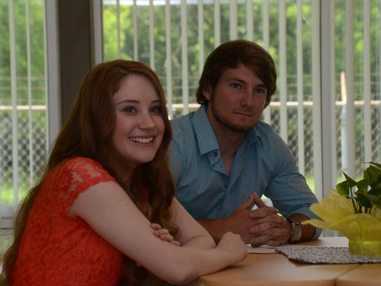 ANI Aiken Virtual Program graduate Kathryn Haston, 18 (left), with brother Zach Smith, was honored Wednesday, May 6, 2015 for being the first student to complete all four years of high school through the online program through Aiken Virtual Program. Haston