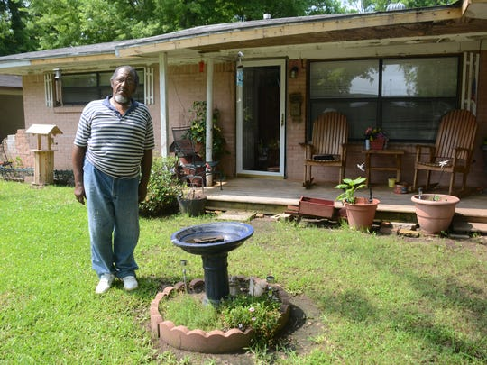 Thomas Johnson Jr., who lives on Linwood Lane near the South Traffic Circle, has rejected a government offer to buy his house as part of the Greenway Park Subdivision Acquisition Project. Nearly all of the houses near him will be demolished in the flood-mitigation project.