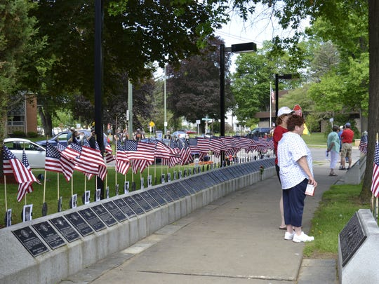 Flags wave above the plaques in Veterans Memorial Park in Endicott on Monday during the village's Memorial Day parade.