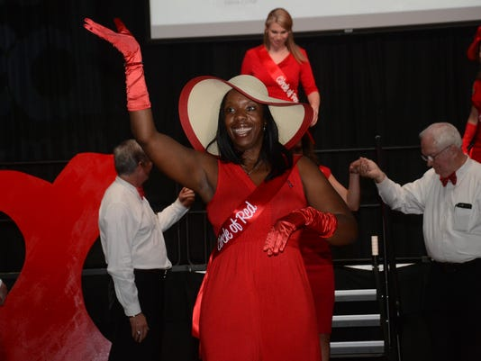 ANI Go Red Sharifa Baker Bevels waves after she and other members of the Circle of Red are intro ducted at the Central Louisiana Go Red for Women luncheon held Friday, June 5, 2015. Women in the Circle of Red held fund research, educate and promote heart h