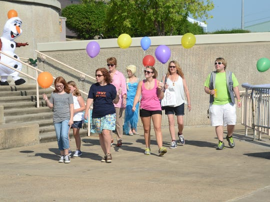 Participants walk in the Cenla Pride Stroll on Saturday at the Levee Park Amphitheatre in downtown Alexandria.