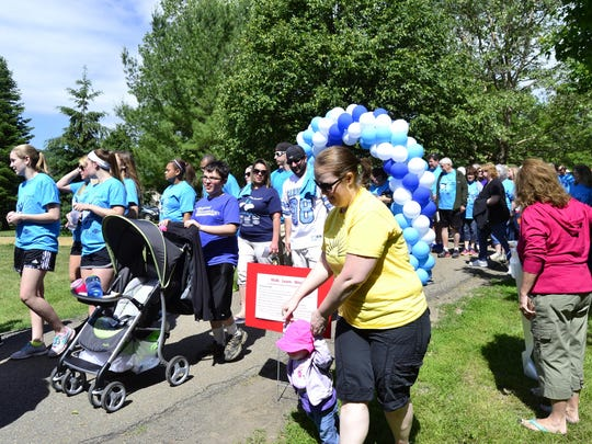 Walkers set off at the Stepping Out to Cure Scleroderma walk Sunday in Otsiningo Park.