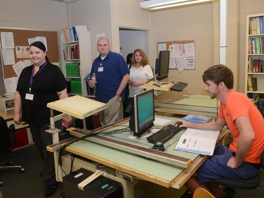 ANI Jump Start Tyler Stephens (right), a drafting student at Central Louisiana Technical Community College, studies while teachers from various schools take a tour of the classroom and campus Tuesday, June 9, 2015. -Melinda Martinez/The Town