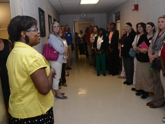 Lisa Henton (left), business management instructor and program chair of the business office administration department at Central Louisiana Technical Community College, addresses teachers from various schools who are taking a tour of the classroom and campus Tuesday.