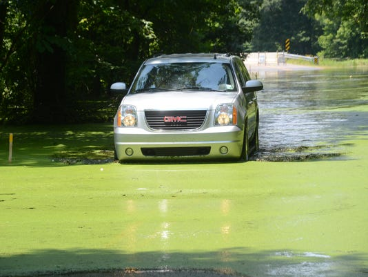 ANI Rigolette Road An SUV slowly crosses the water covering Rigolette Road Wednesday, June 10, 2015.-Melinda Martinez/The Town Talk