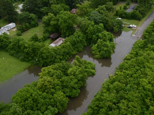 ANI Wardville Water covers Crepe Myrtle Street in Wardville and some of the surrounding area Saturday, June 13, 2015.-Melinda Martinez/The Town Talk