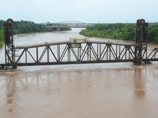 ANI Fort Buhlow Recreation Area The Red River is rising close to the train trestle near the Fort Buhlow Recreation Area Saturday, June 13, 2015.-Melinda Martinez/The Town Talk