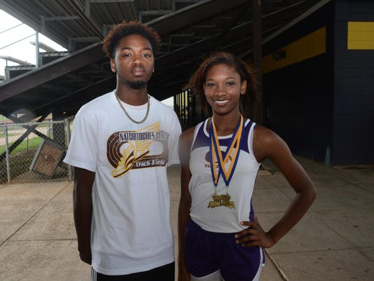 ANI All Cenla Track Natchitoches Central's Correion Mosby (left) and Oakdale's Heaven Terrell.-Melinda Martinez/The Town Talk