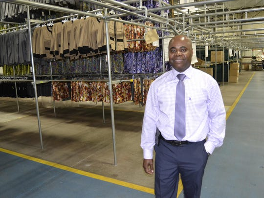 Daniel Jean-Joseph, director of warehouse operations for Carlisle Etcetera, in the middle of the company's new distribution center in Westminster, Md., where it relocated after years in New York.