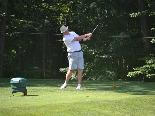 Mike Tungate drives the ball on the second day of the City Senior Golf Championship at Binder Park Golf Course.