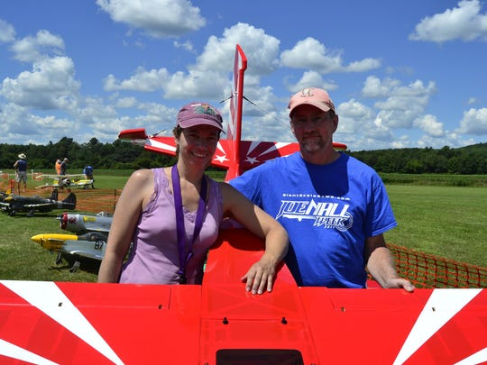 Cindy Whritenour and Rodney Steward, from Washingtonville, New York, with the giant-scale model airplane they flew Sunday at the Chenango Bridge Airport for the 30th annual Fun-Fly.