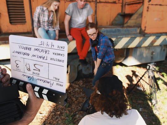 Tamzin Merchant, center in blue, on the set of 'American Virgin.'