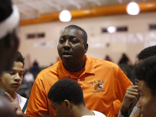 FAMU DRS coach Sean Crowe talks to his team during the Rattlers first-round playoff win. Crowe, in his second year, has the Rattlers back in the state tournament.